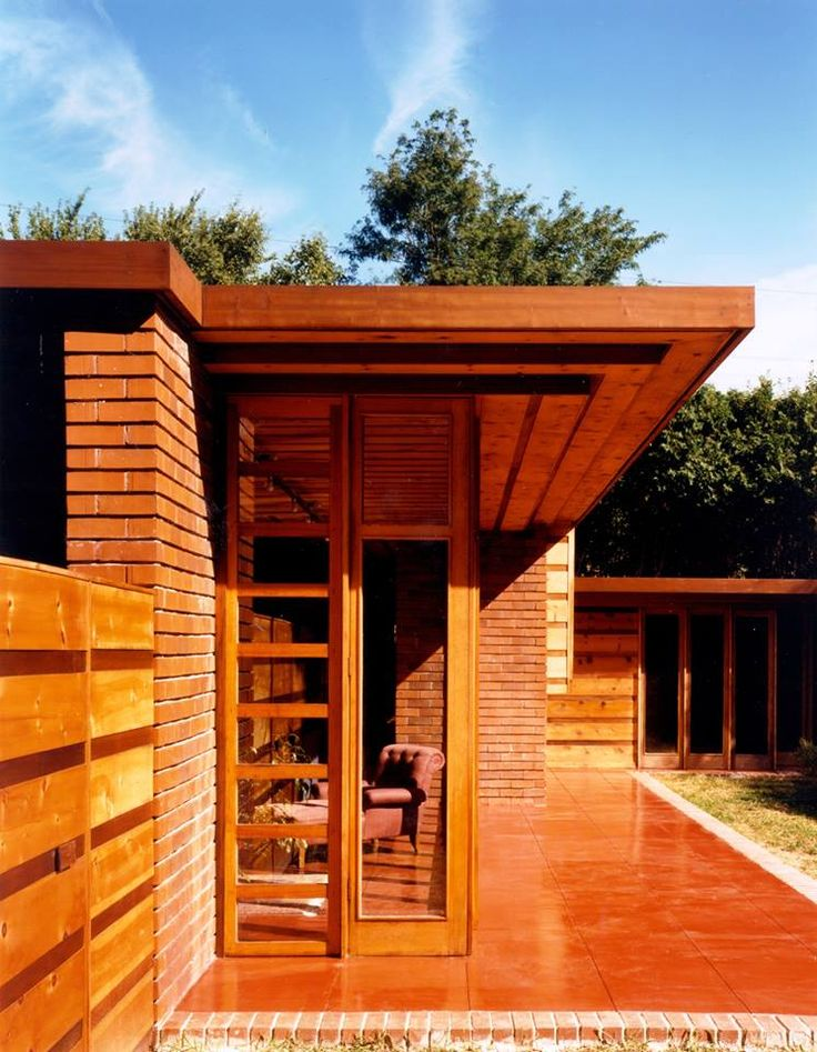 The materials of the Usonian house were to be recognized as nature's own: wood, stone, or baked clay in the form of bricks, and glass curtain walls, clerestories, and casement windows sheltered under overhanging soffits.